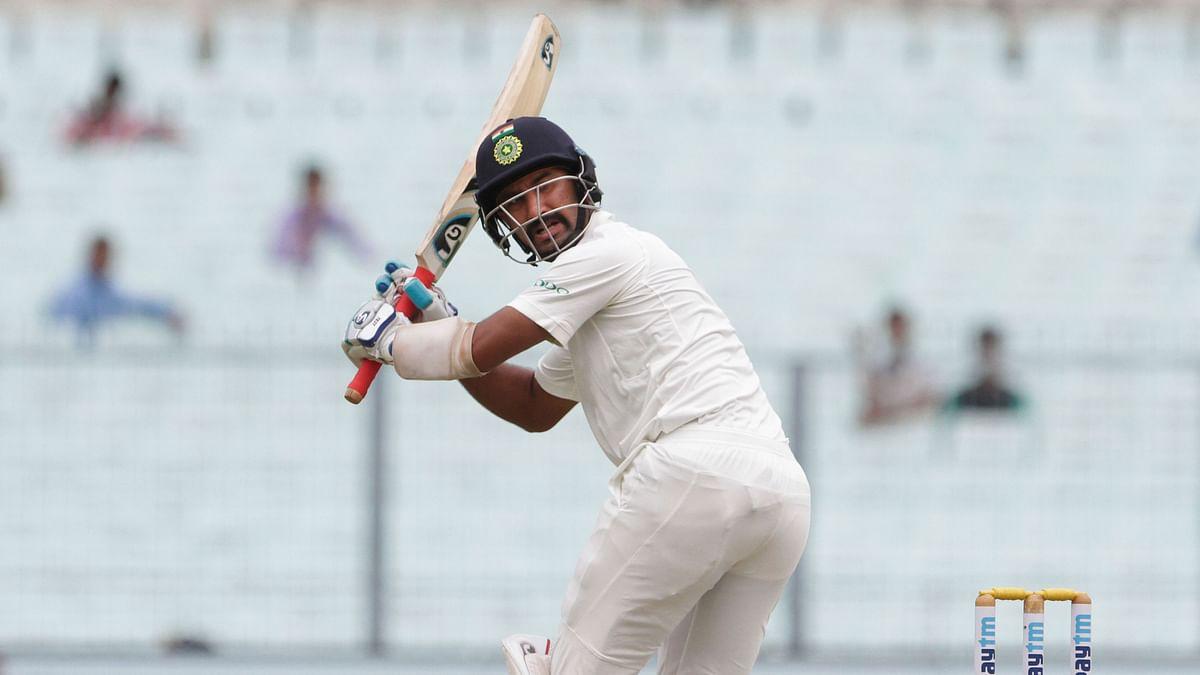 Cheteshwar Pujara is three runs short of a half-century in the Kolkata Test.