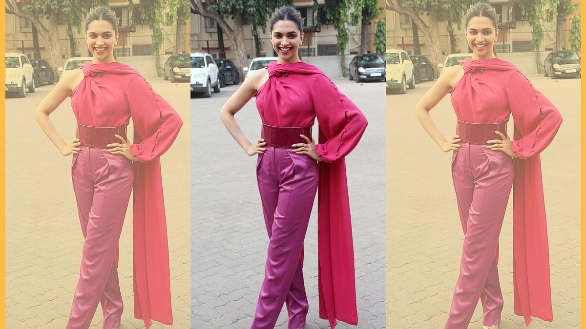 Deepika Padukone poses for photographers at a studio in Mumbai.