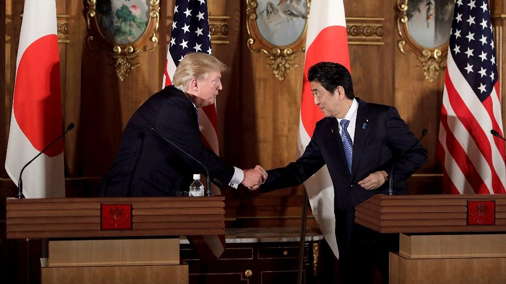 President Trump and Japanese Prime Minister Shinzo Abe shake hands during a joint news conference at the Akasaka Palace, Tokyo on 6 November 2017