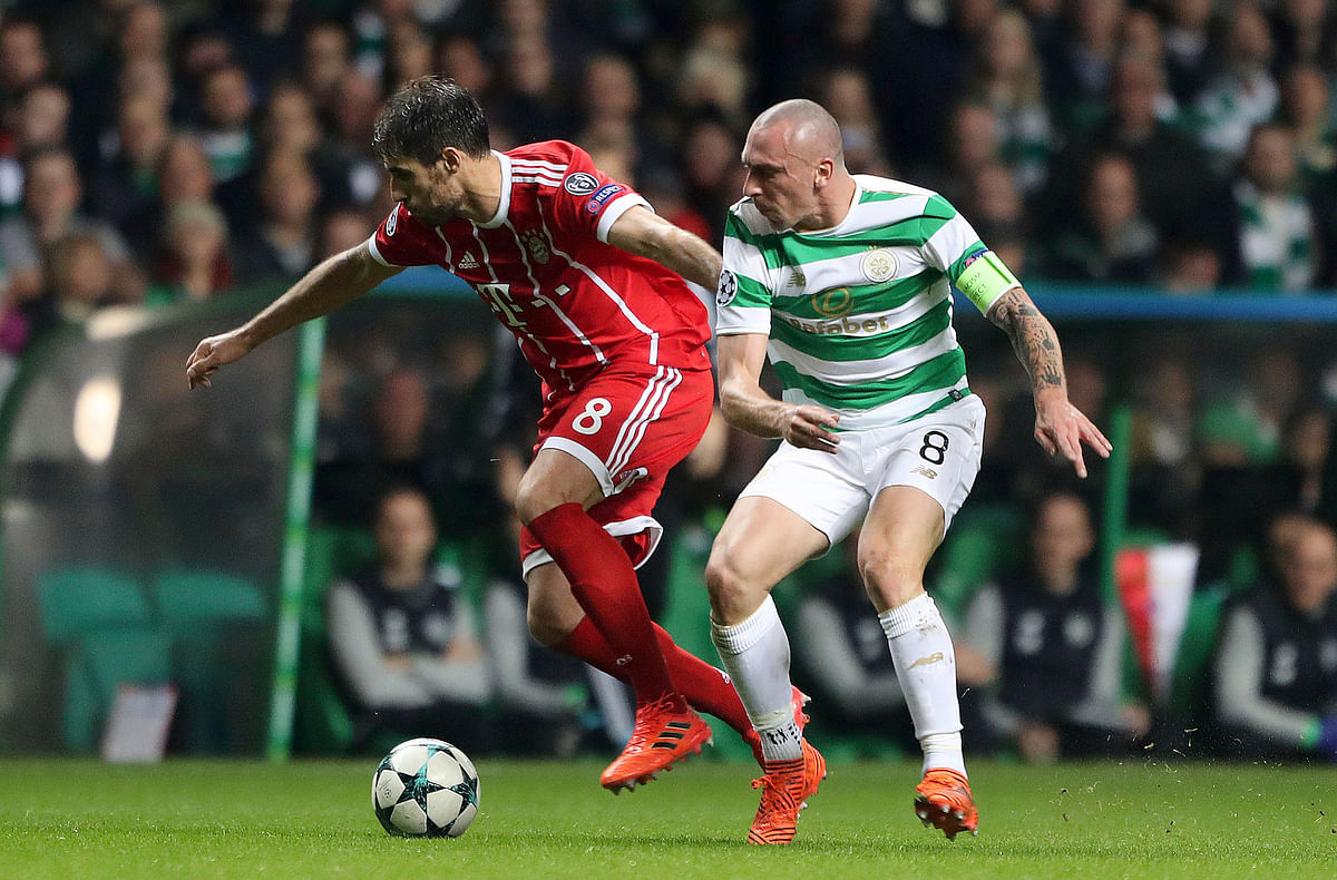 Bayern Munich's Aguinaga Javi Martinez, left, and Celtic's Scott Brown battle for the ball.