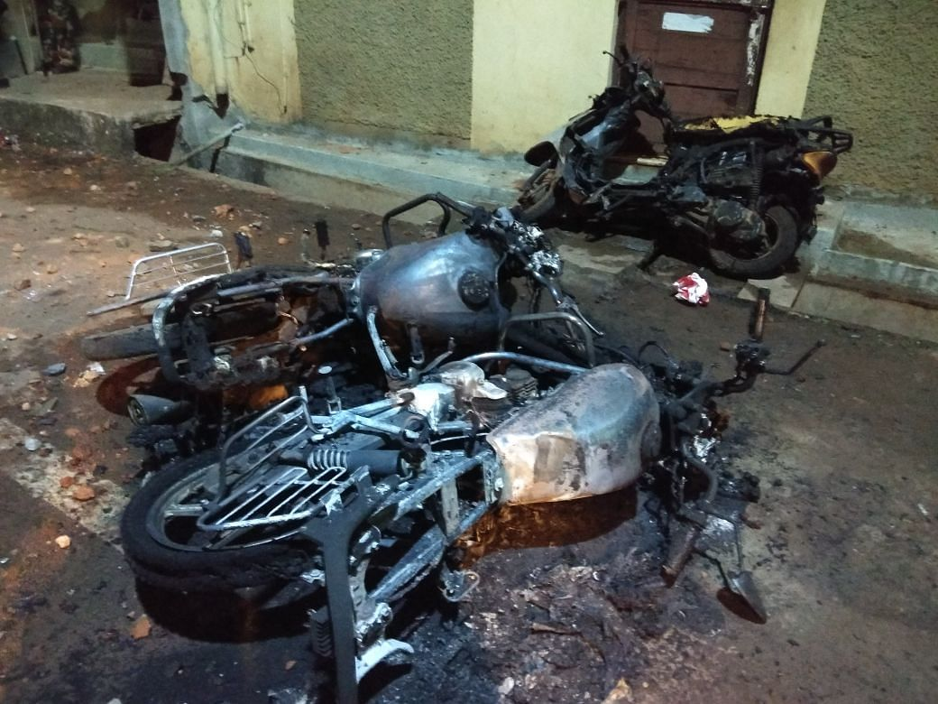 A bike charred in the clashes.