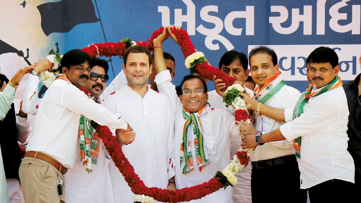 Rahul Gandhi being garlanded by the supporters during a public meeting in Killa Pardi in Valsad district on Friday