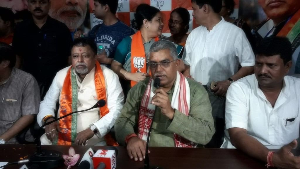 Mukul Roy with state BJP President Dilip Ghosh at the Kolkata BJP office on Monday.