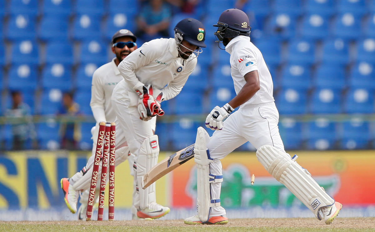 Wriddhiman Saha effects a stumping to dismiss Sri Lanka's Niroshan Dickwella.