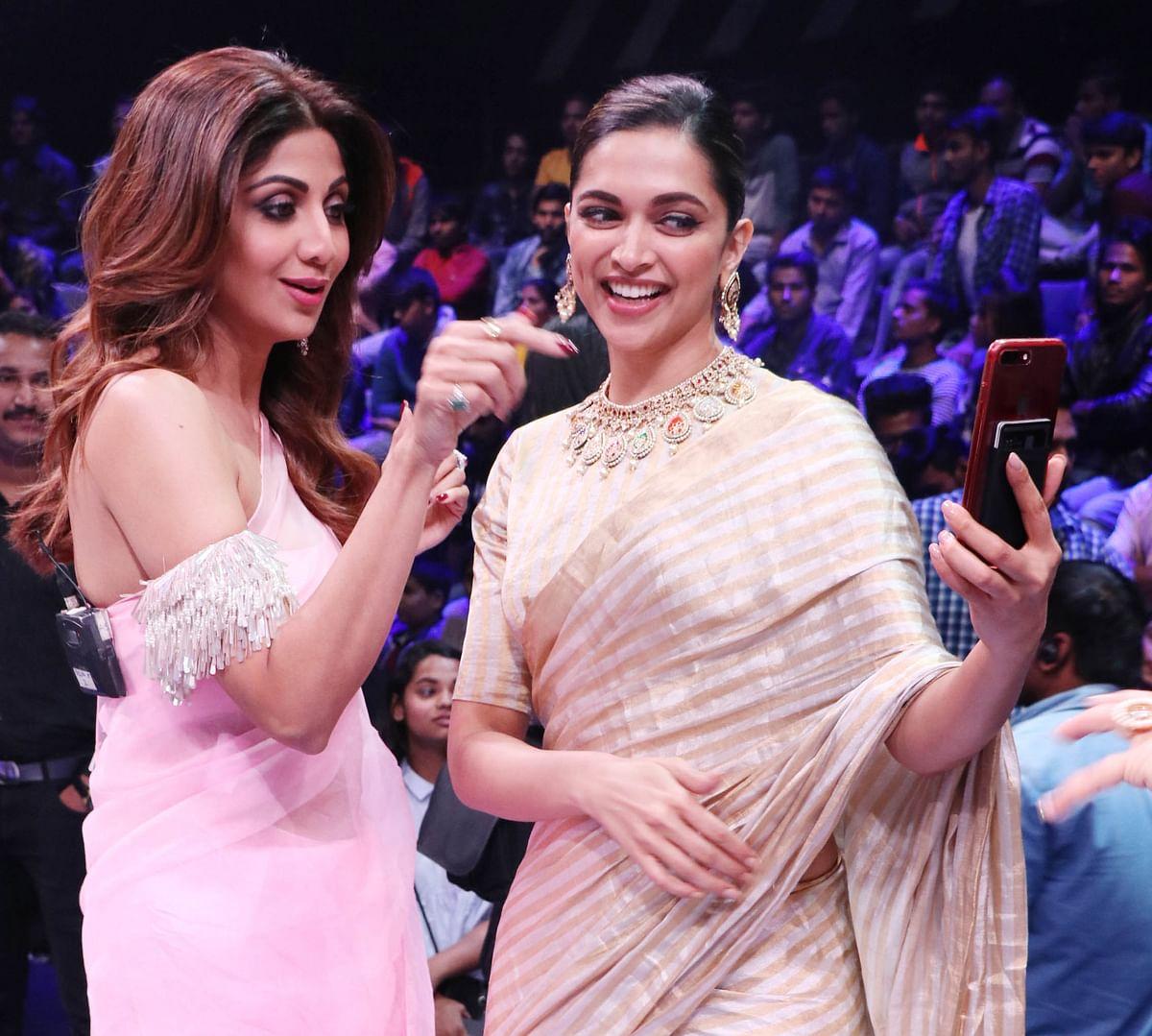 Deepika Padukone with Shilpa Shetty on the sets of a dance reality TV show.