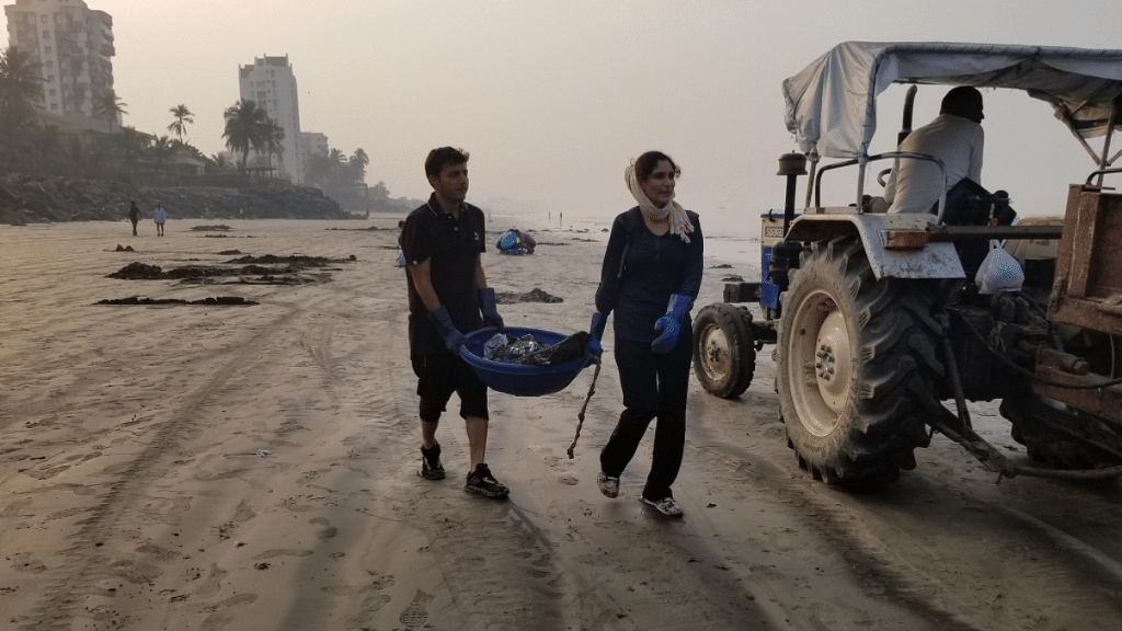 Volunteers help out with the beach clean-up drive at Versova..