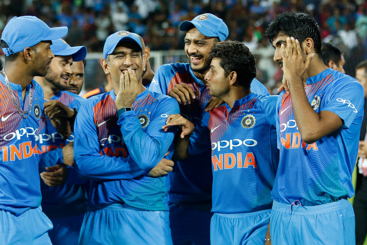 MS Dhoni with his Indian team-mates after the series win in Thiruvananthapuram