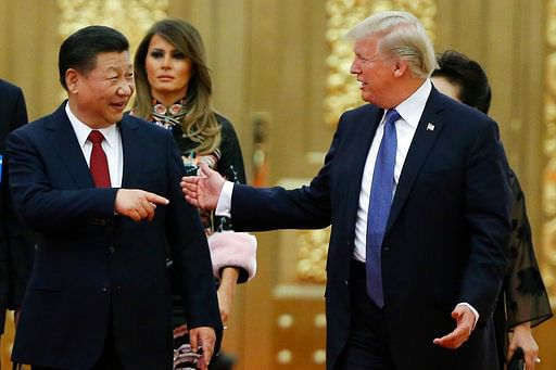 US President Donald Trump and China's President Xi Jinping arrive for the state dinner with the first ladies at the Great Hall of the People in Beijing on 9 November 2017.