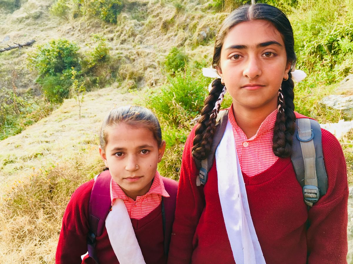 Muskaan (on the right) says her parents don't allow her to get cattle and wood for the house from the forest anymore.