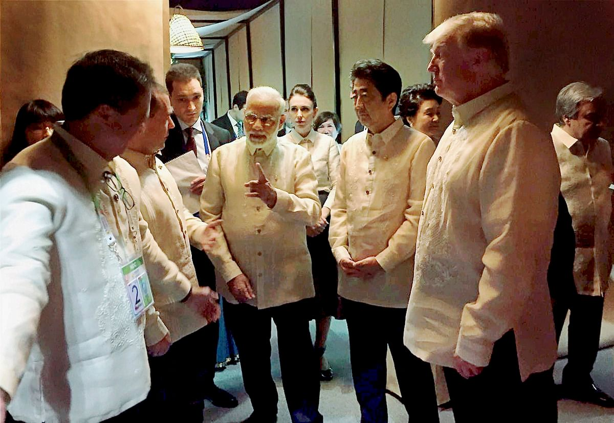 PM Modi with Donald Trump and Shinzo Abe at the ASEAN Summit dinner in Manila.