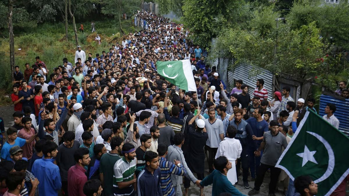 People attend funeral procession of militant Burhan Wani at his village in Tral of Jammu and Kashmir's Pulwama district on 9 July 2016.