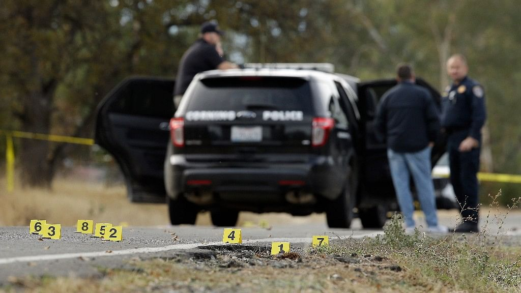 Yellow tags mark where bullet casings were found at one of the scenes of the shooting spree