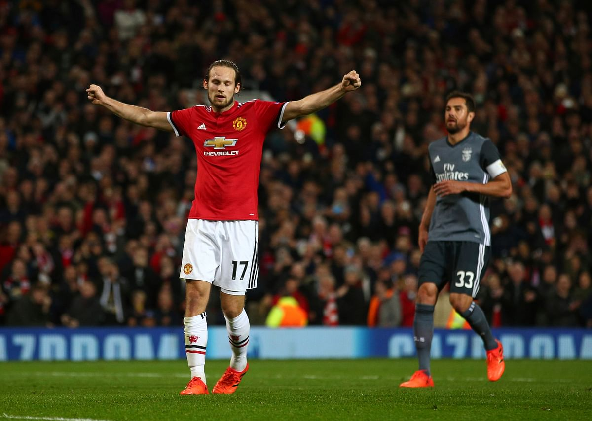 Manchester United's Daley Blind celebrates after scoring his side's second goal against Benfica.