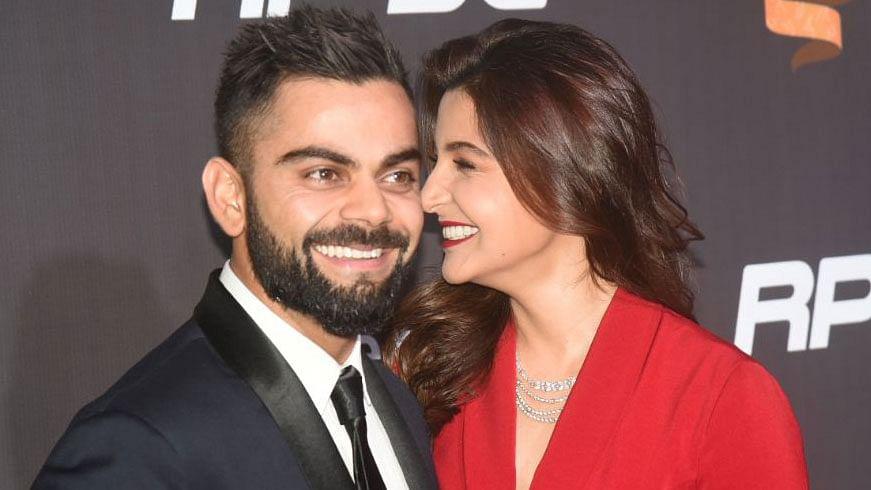 Virat Kohli and Anushka Sharma share a moment on the red carpet of the Indian Sports Honours in Mumbai.