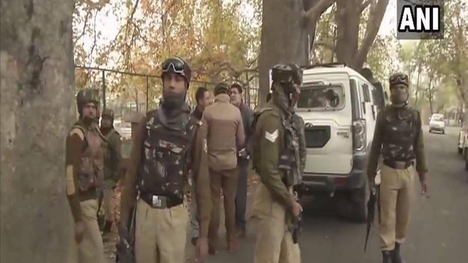 Three militants travelling in a car opened fire on a police team at the Zakura crossingon Srinagar-Ganderbal road.