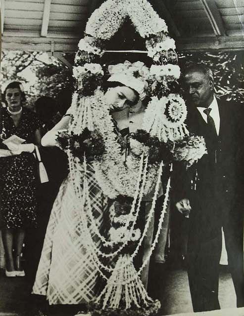 Queen Elizabeth II examining a giant garland in India, in 1961.