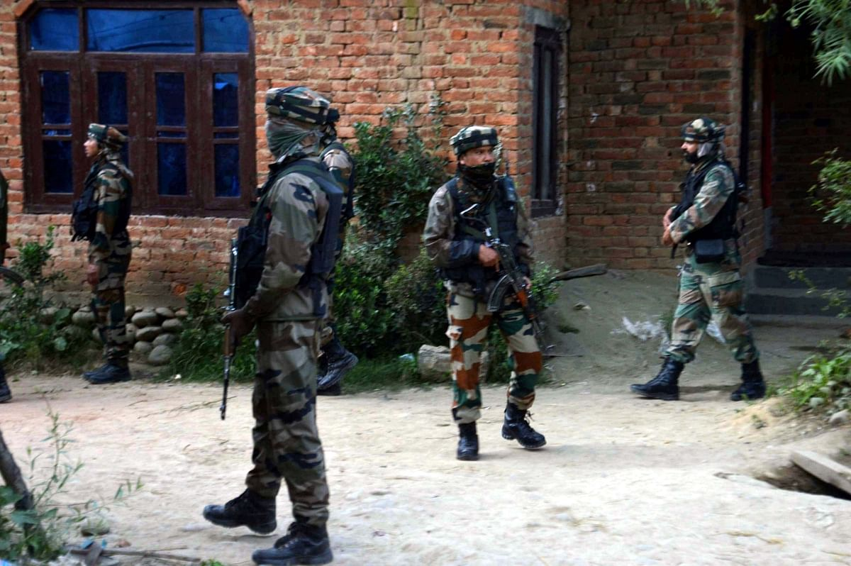 Soldiers take position after militants attacked a police vehicle killing a policeman and injuring other in Jammu and Kashmir's Kulgam district on 14 October, 2017.
