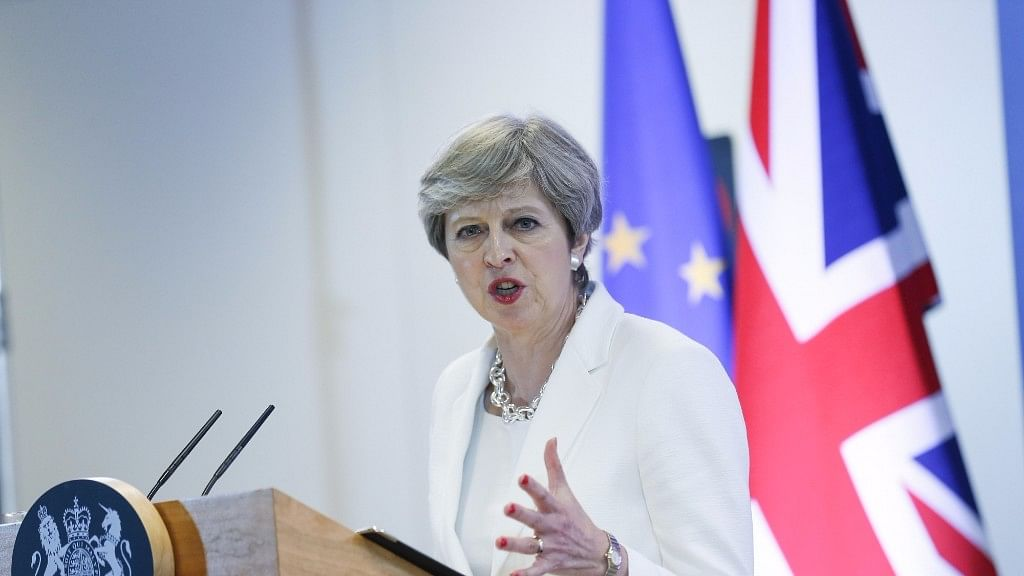 British Prime Minister Theresa May attends a press conference at the end of a two-day EU Summit in Brussels.
