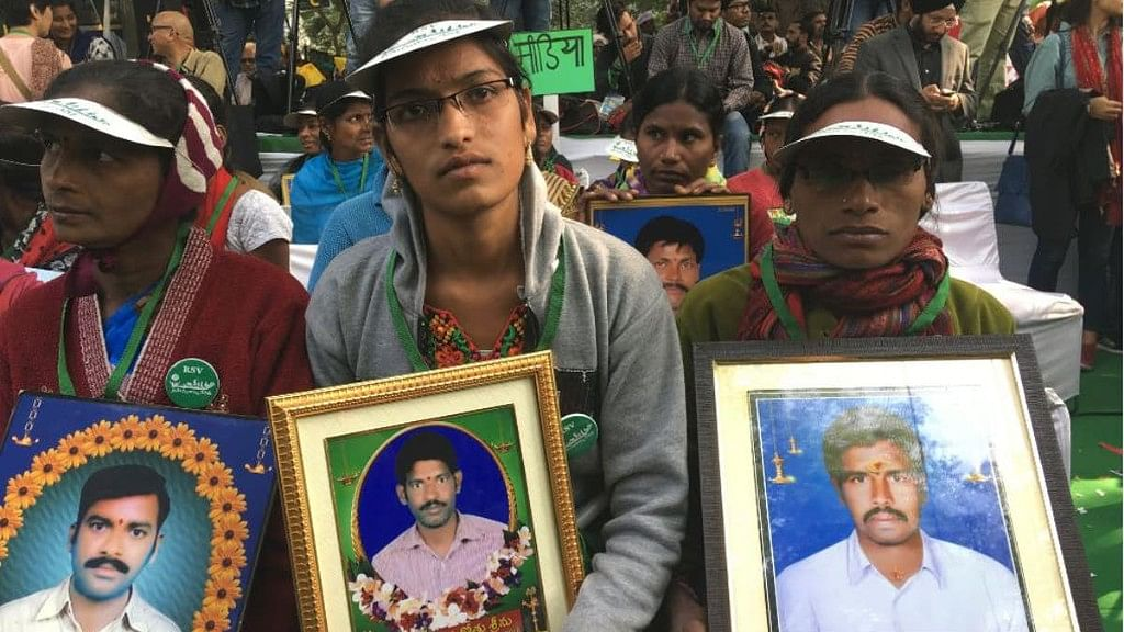 Family members of farmers who committed suicide participate in the rally in New Delhi.