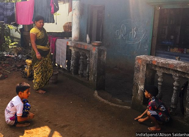 Lalita Patil and her sons Harshad and Tanish outside their home and the attached shop. Patil had reopened the store two years ago after her husband passed away in 2012. Her family of three is entirely dependent on the shop's earnings.