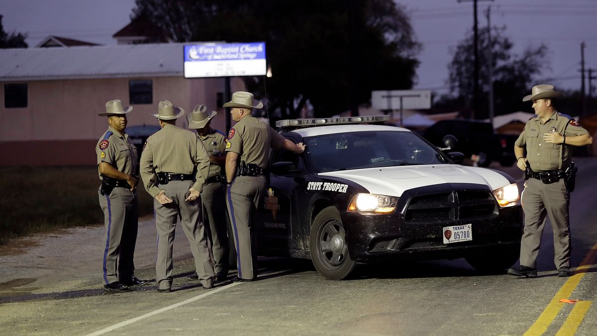 Law enforcement officials continue to investigate the scene of a shooting at the First Baptist Church of Sutherland Springs, Tuesday, 7 November, in  Texas.