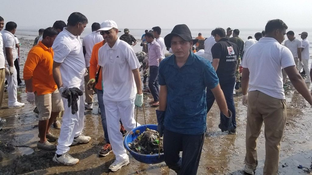 Afroz Shah cleans up Mumbai's Versova beach with other voluteers.