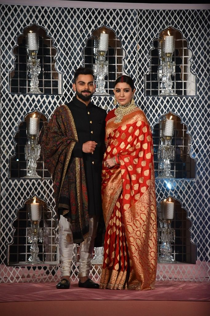 <p>Virat Kohli and Anushka Sharma at the Delhi reception.<i></i></p>