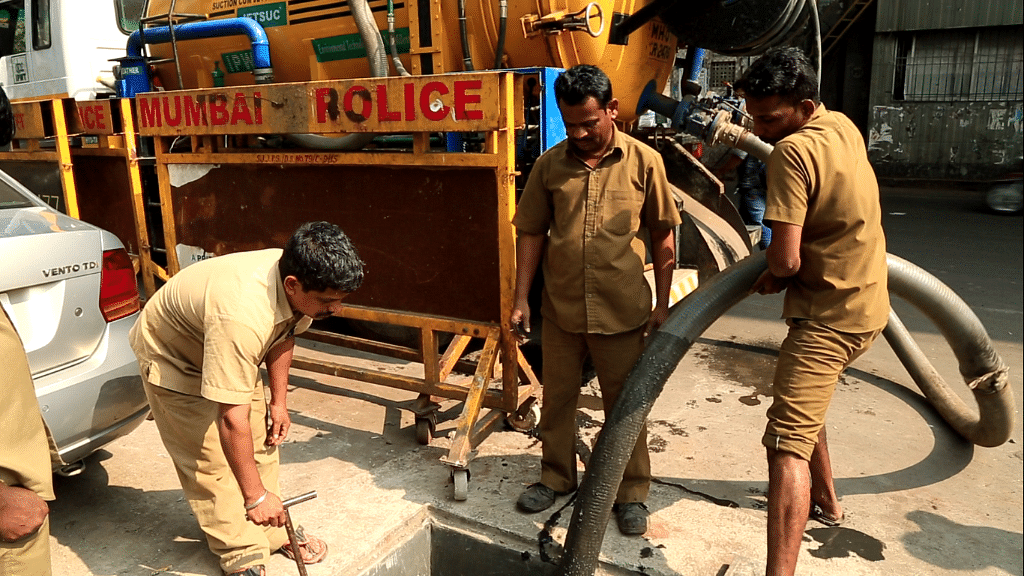 BMC workers attempt to clean up a clogged drain.