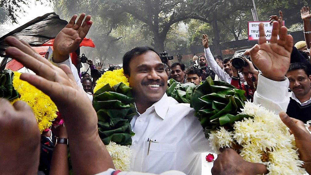 Former Telecom minister A Raja reacts as he celebrates along with his supporters after he was acquitted by a special court in the 2G scam case, in New Delhi.
