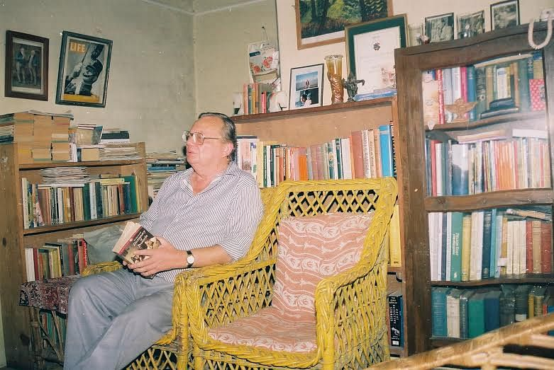 <p>An old photograph of Ruskin Bond in his home in the hills.</p>