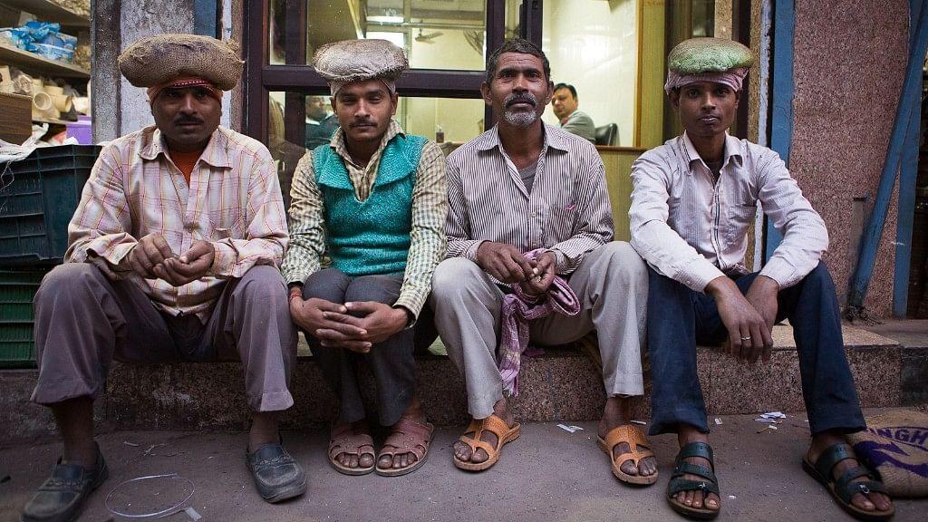 Jhalliwalas of Chawri Bazar, Old Delhi waiting for work in the evening. (L-R: Mahender, Brij Kishore,  Dharbhari and Amit)