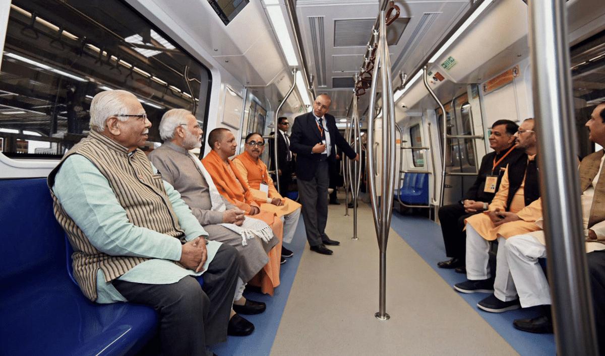 Prime Minister Narendra Modi rides the Magenta Line with UP CM Yogi Adityanath.