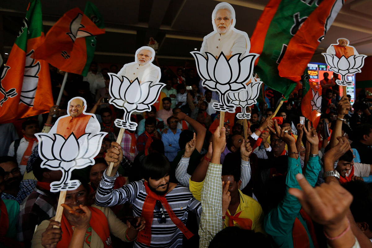 Supporters of BJP celebrate their party's victory in Gujarat state Assembly elections in Gandhinagar.