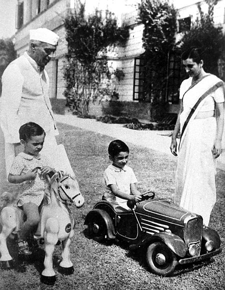 Jawaharlal Nehru, Indira Gandhi look over Rajiv Gandhi (on toy horse) and Sanjay Gandhi (in toy car).