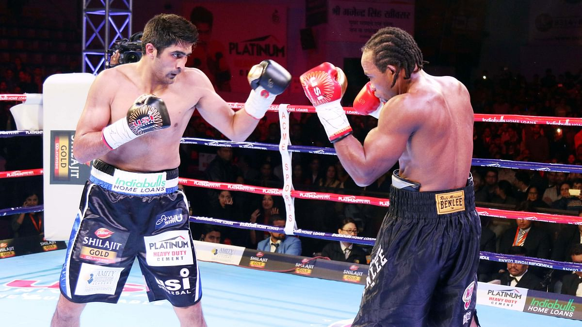Vijender Singh (left) last defended his WBO Oriental and Asia Pacific Super middleweight titles. against Ernest Amuzu in 2017.
