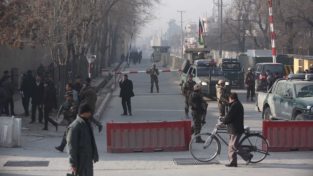Afghan security personnel arrive at the site of suicide attack in Kabul, Afghanistan on Monday, 25 December.