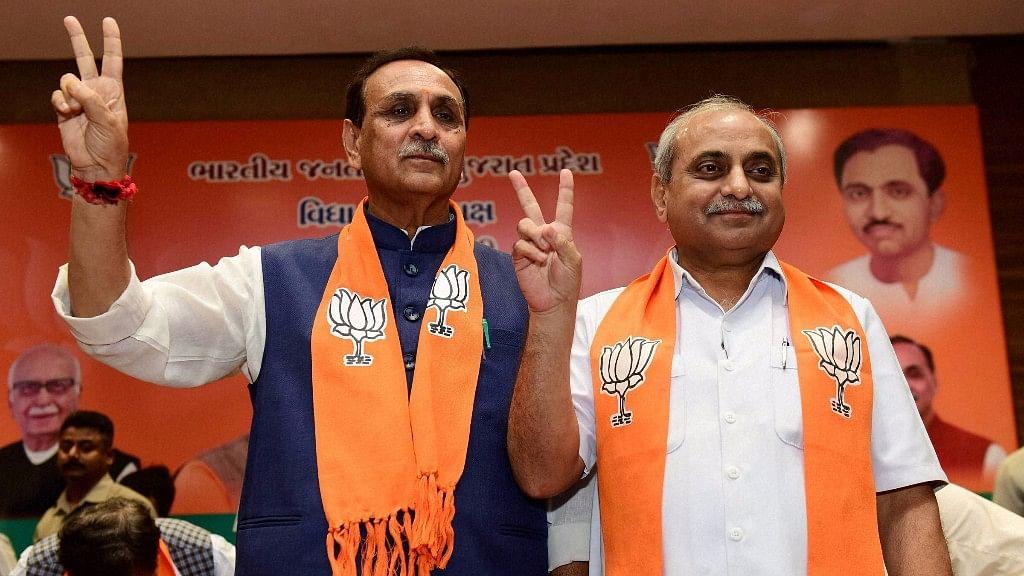 Gujarat Chief Minister Vijay Rupani (left)  and deputy Chief Minister Nitin Patel.