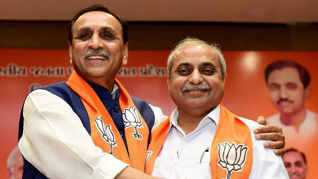 Gujarat Chief Minister Vijay Rupani and his deputy Nitin Patel retained their posts after the BJP won the Gujarat assembly polls.