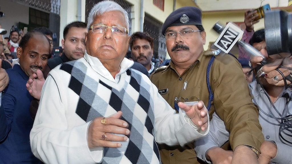 RJD supremo Lalu Prasad Yadav escorted by police officials.