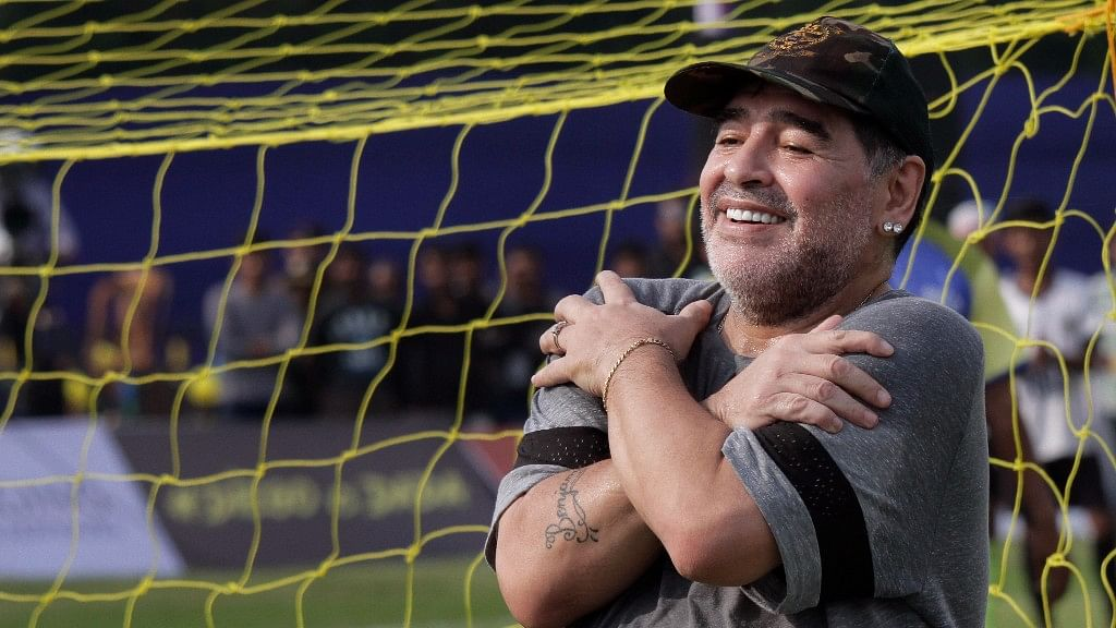 Diego Maradona, gestures to media as he attends a football clinic and workshop for young aspiring soccer players in Kadambagachhi, about 45 kilometers (28 miles) north of Kolkata, on 12 December 2017.