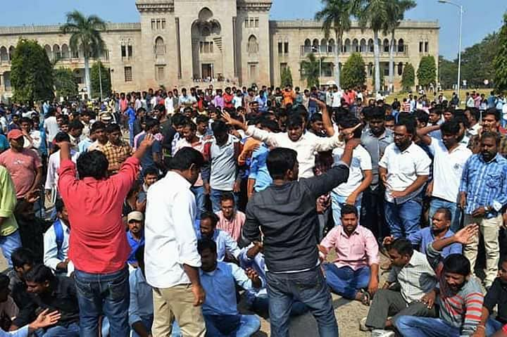 Students protest outside the college building.