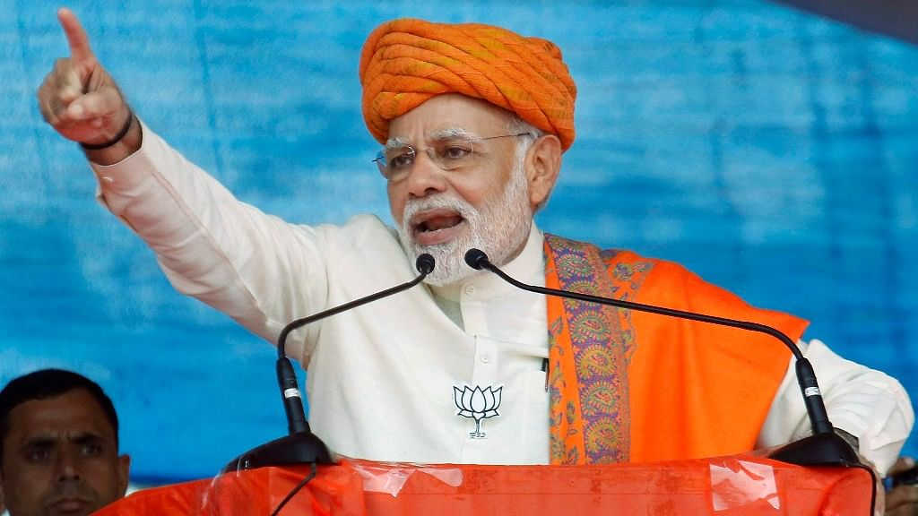 Prime Minister Narendra Modi addresses an election campaign rally, at Dhandhuka village of Ahmedabad district.