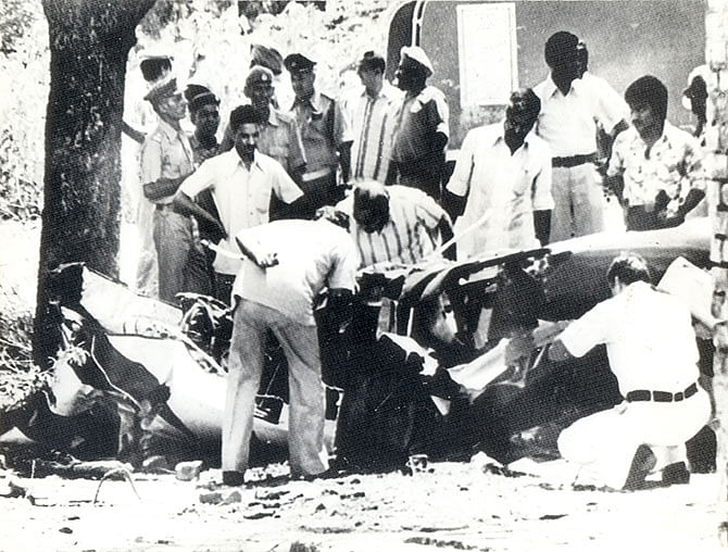 Investigators examine the wreckage of Sanjay Gandhi's Pitts S-2A plane.
