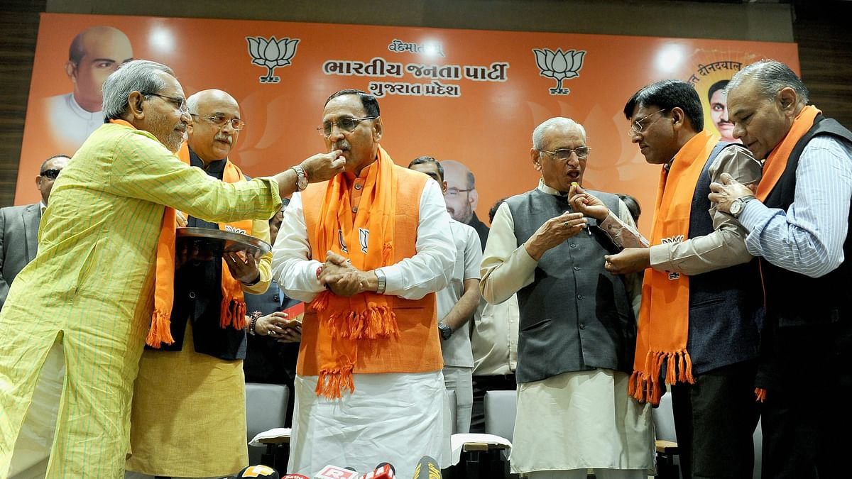 BJP leaders offering sweets to Gujarat Chief Minister Vijay Rupani after the party's win in the state assembly election.