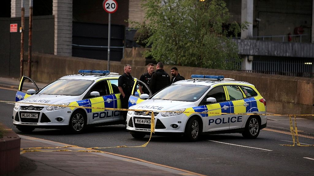 <p>Police stand guard near the UK's Manchester Arena after a blast at Ariana Grande concert in May 2017.</p>