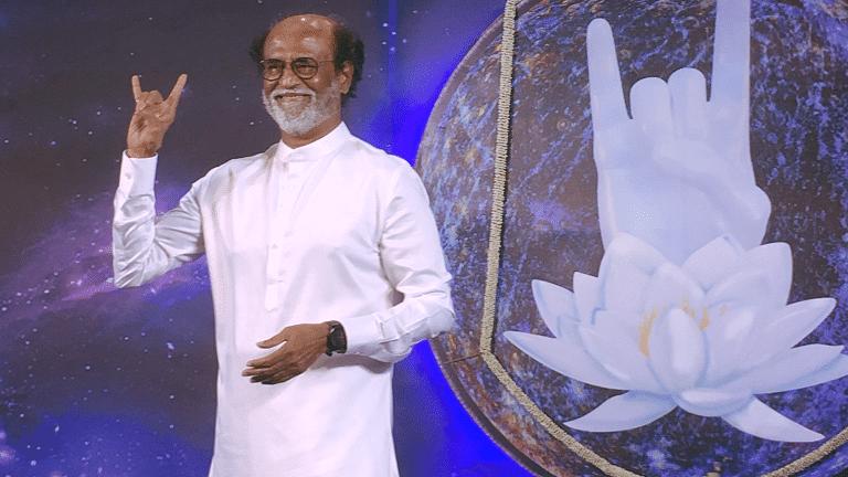 "Rajini makes the ""baba"" symbol, a trademark of his character from the movie <i>Baba</i>."
