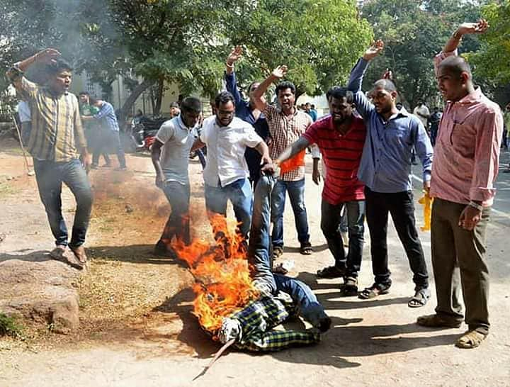 Students burn effigy.