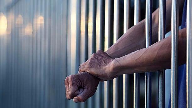 <p>Representational image of prisoner behind bars.&nbsp;</p>