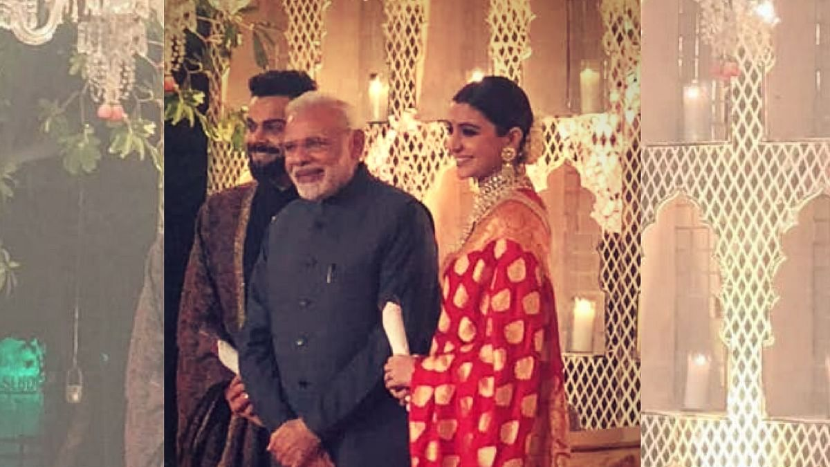 <p>PM&nbsp; Modi with Virat Kohli and Anushka Sharma.</p>