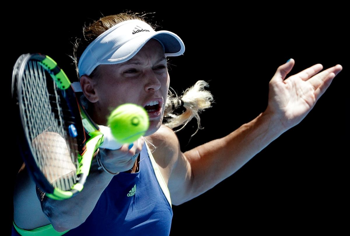 Caroline Wozniacki came through a late bout of nerves to reach the Australian Open final for a first time.